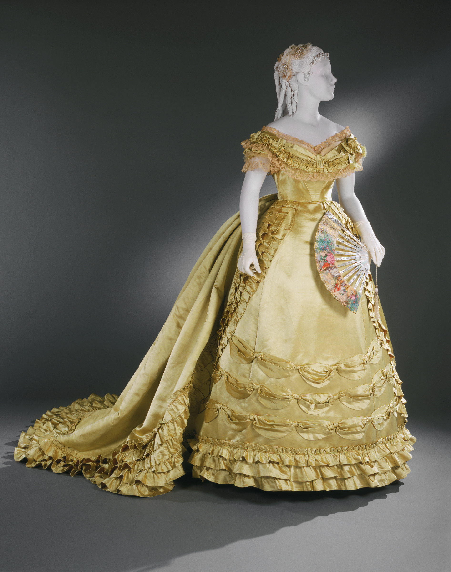 Charles Frederick Worth, Evening Bodice and Skirt, c. 1866–68, yellow silk satin with lace and tulle, Philadelphia Museum of Art.